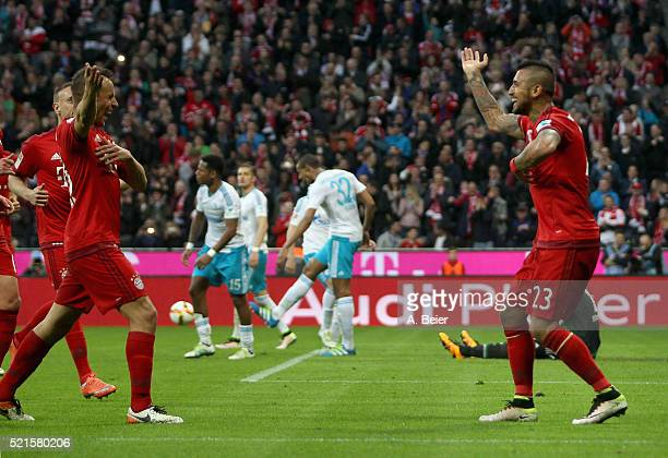 Arturo Vidal of Bayern Muenchen celebrates his goal dancing with teammate Rafinha during the Bundesliga match between FC Bayern Muenchen and FC...