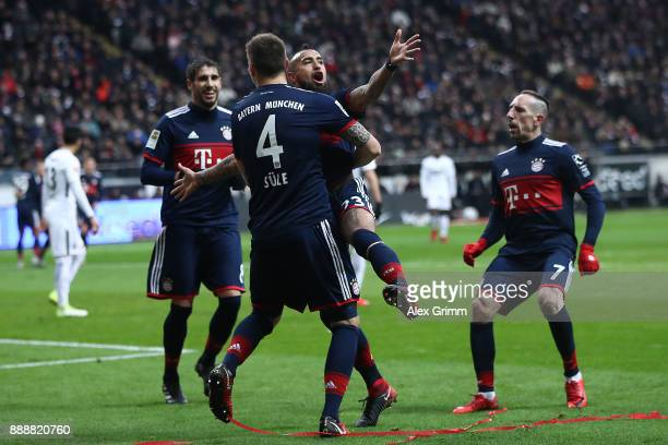 Arturo Vidal of Bayern Muenchen celebrates his goal to make it 10 with Niklas Suele of Bayern Muenchen during the Bundesliga match between Eintracht...