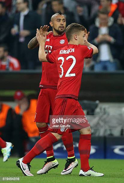 Arturo Vidal of Bayern Muenchen celebrates his goal with Joshua Kimmich during the UEFA Champions League quarter final first leg match between FC...