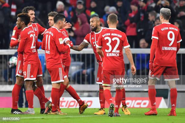 Arturo Vidal of Bayern Muenchen celebrates with James Rodriguez of Bayern Muenchen after he scored a goal to make it 10 during the Bundesliga match...