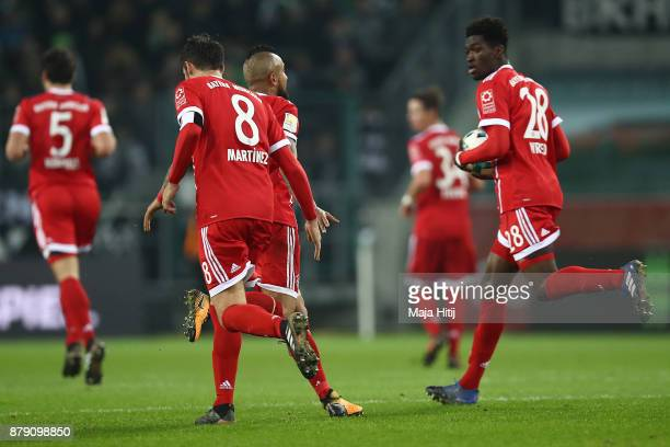 Arturo Vidal of Bayern Muenchen celebrates with Javi Martinez of Bayern Muenchen and Kwasi Okyere Wriedt of Muenchen after he scored a goal to make...