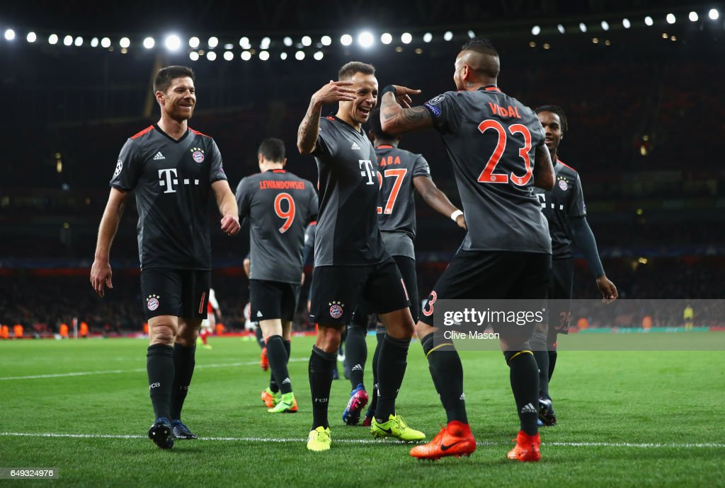Arturo Vidal of Bayern Muenchen (23) celebrates with Rafinha and team mates as he scores their fourth goal during the UEFA Champions League Round of 16 second leg match between Arsenal FC and FC Bayern Muenchen at Emirates Stadium on March 7, 2017 in London, United Kingdom.