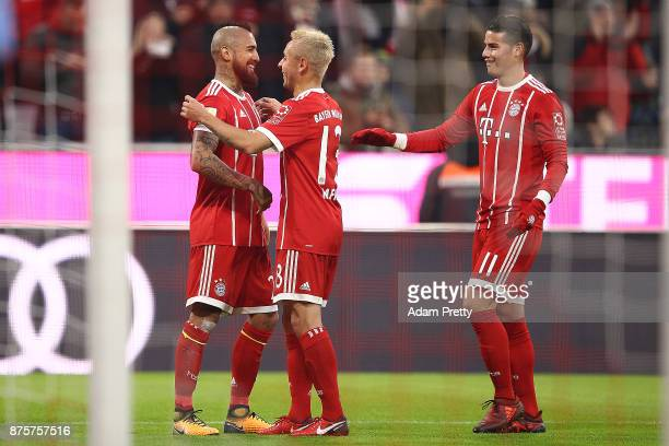 Arturo Vidal of Bayern Muenchen celebrates with Rafinha of Bayern Muenchen and James Rodriguez of Bayern Muenchen after he scored a goal to make it...