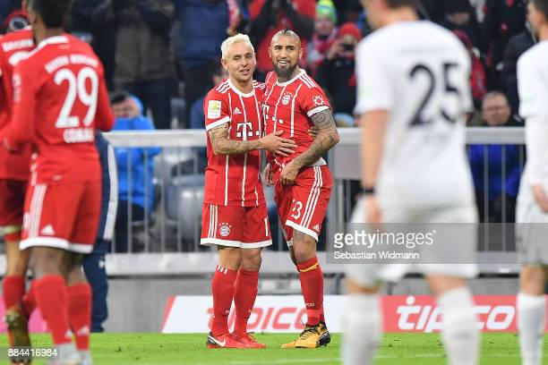 Arturo Vidal of Bayern Muenchen celebrates with Rafinha of Bayern Muenchen after he scored a goal to make it 10 during the Bundesliga match between...