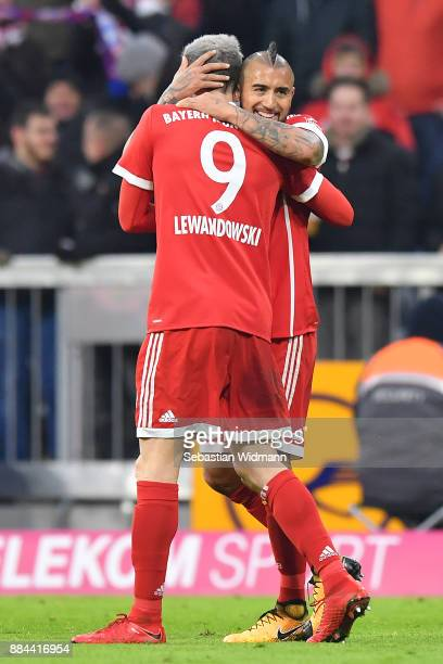 Arturo Vidal of Bayern Muenchen celebrates with Robert Lewandowski of Bayern Muenchen after he scored a goal to make it 10 during the Bundesliga...