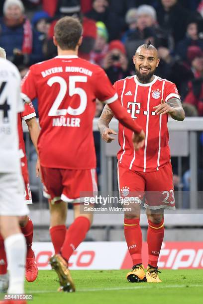 Arturo Vidal of Bayern Muenchen celebrates with Thomas Mueller of Bayern Muenchen after he scored a goal to make it 10 during the Bundesliga match...