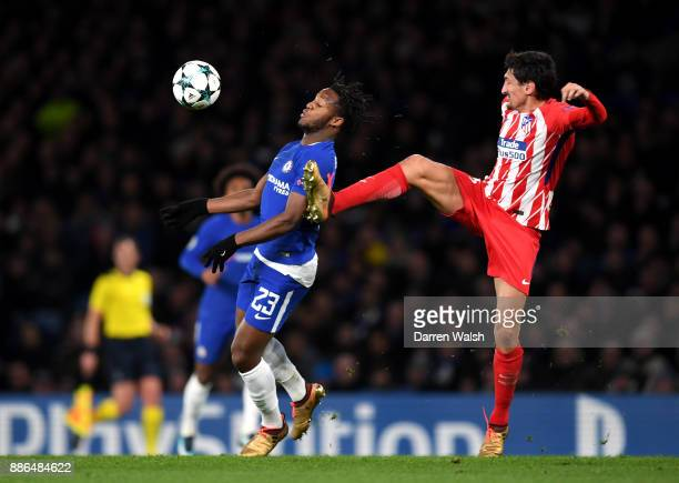 Arturo Vidal of Bayern Muenchen is challenged by Stefan Savic of Atletico Madrid during the UEFA Champions League group C match between Chelsea FC...