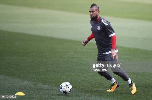 Arturo Vidal of Bayern Muenchen looks to pass during a training session prior to the UEFA Champions League QuarterFinal first leg match against...