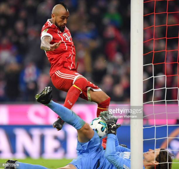 Arturo Vidal of Bayern Muenchen misses a chance against goalkeeper Marwin Hitz of Augsburg during the Bundesliga match between FC Bayern Muenchen and...