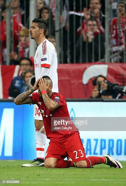 Arturo Vidal of Bayern Muenchen reacts after missing a goal while Andre Almeida of Benfica looks on during the UEFA Champions League quarter final...