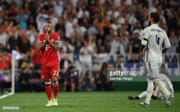 Arturo Vidal of Bayern Muenchen reacts to being sent off during the UEFA Champions League Quarter Final second leg match between Real Madrid CF and...