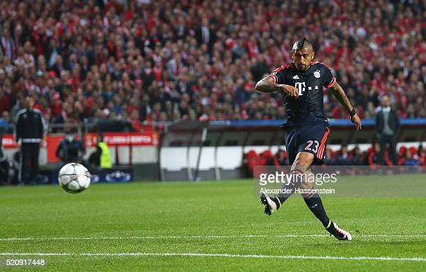 Arturo Vidal of Bayern Muenchen scores his team's opening goal during the UEFA Champions League quarter final second leg match between SL Benfica and...