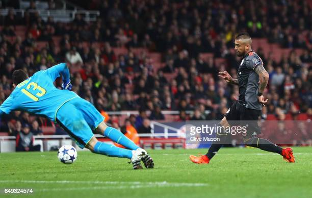 Arturo Vidal of Bayern Muenchen scores their fifth goal past David Ospina of Arsenal during the UEFA Champions League Round of 16 second leg match...