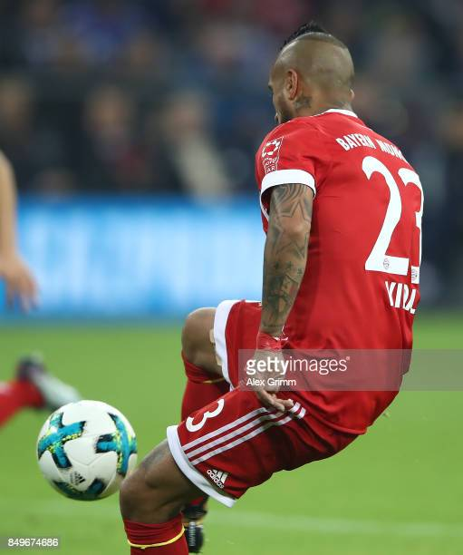 Arturo Vidal of Bayern Muenchen shoots on target to score his teams third goal to make it 30 during the Bundesliga match between FC Schalke 04 and FC...