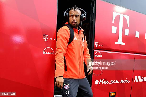Arturo Vidal of Bayern Muenchen walks out of the bus prior to the Bundesliga match between SV Darmstadt 98 and Bayern Muenchen at Stadion am...