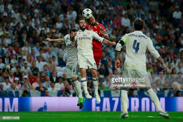 Arturo Vidal of Bayern Muenchen wins the header before Daniel Carvajal of Real Madrid CF during the UEFA Champions League Quarter Final second leg...