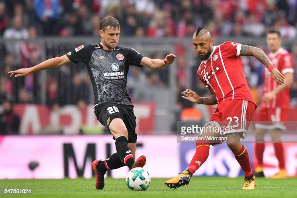 Arturo Vidal of Bayern Muenchen with Fabian Frei of Mainz during the Bundesliga match between FC Bayern Muenchen and 1 FSV Mainz 05 at Allianz Arena...