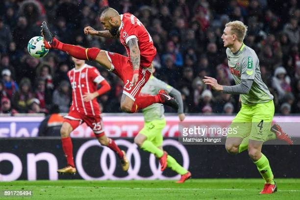 Arturo Vidal of Bayern Munich and Frederik Sorensen of 1FC Koeln battle for the ball during the Bundesliga match between FC Bayern Muenchen and 1 FC...