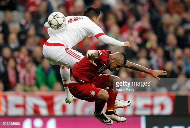 Arturo Vidal of Bayern Munich and Raul Jimenez of Benfica jump for the ball during the UEFA Champions League quarter final first leg match between FC...