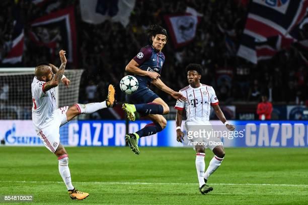 Arturo Vidal of Bayern Munich Edinson Cavani of PSG and David Alaba of Bayern Munich during the Uefa Champions League match between Paris Saint...