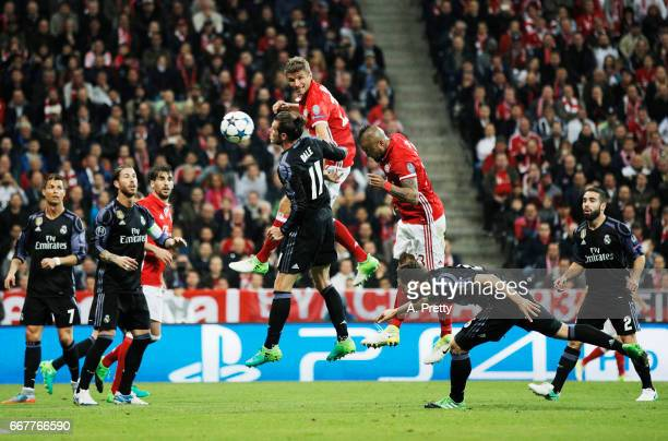 Arturo Vidal of Bayern Munich scores the first goal during the UEFA Champions League Quarter Final first leg match between FC Bayern Muenchen and...