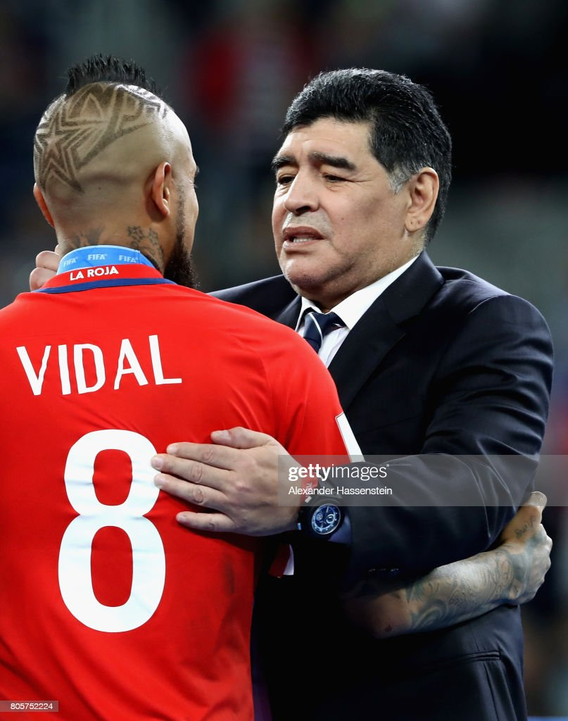 Arturo Vidal of Chile and Diego Maradona embrace after the FIFA Confederations Cup Russia 2017 Final between Chile and Germany at Saint Petersburg Stadium on July 2, 2017 in Saint Petersburg, Russia.