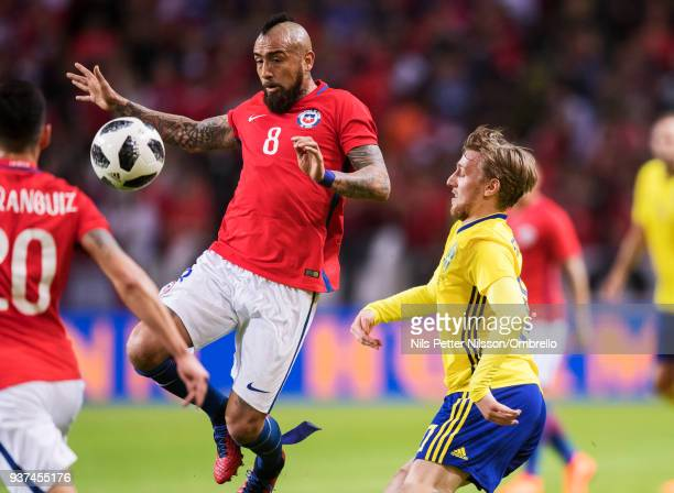 Arturo Vidal of Chile and Emil Forsberg of Sweden competes for the ball during the International Friendly match between Sweden and Chile at Friends...