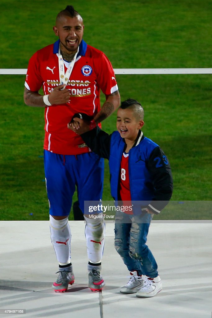 Arturo Vidal of Chile and his son celebrate after the 2015 Copa America Chile Final match between Chile and Argentina at Nacional Stadium on July 04, 2015 in Santiago, Chile.