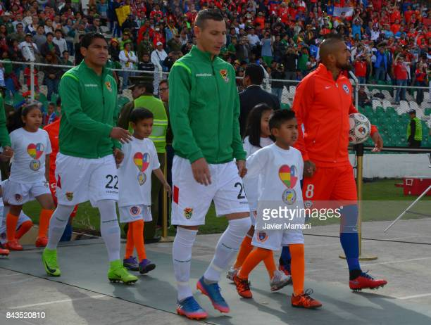 Arturo Vidal of Chile and Pablo Escobar of Bilivia enter the field prior to a match between Bolivia and Chile as part of FIFA 2018 World Cup...