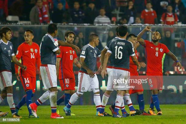 Arturo Vidal of Chile argues with Paulo Da Silva of Paraguay during a match between Chile and Paraguay as part of FIFA 2018 World Cup Qualifiers at...