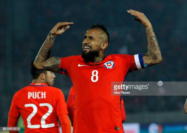 Arturo Vidal of Chile celebrates after scoring the first goal his team during a match between Chile and Burkina Faso as part of an International...