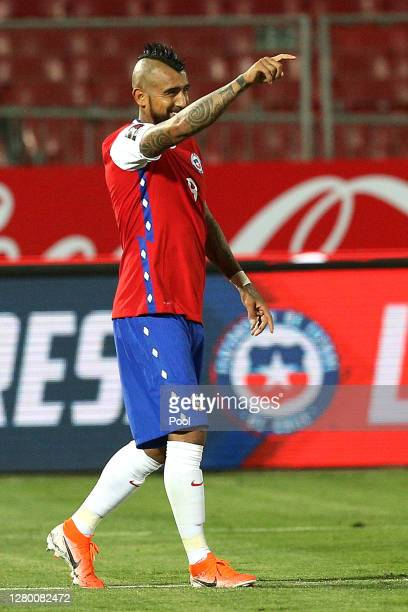 Arturo Vidal of Chile celebrates after scoring the first goal of his team during a match between Chile and Colombia as part of South American...
