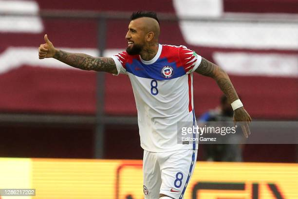 Arturo Vidal of Chile celebrates after scoring the first goal of his team during a match between Venezuela and Chile as part of South American...