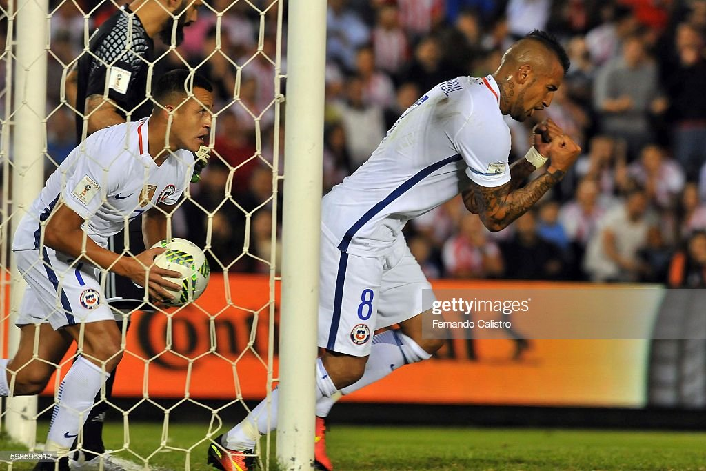 Arturo Vidal of Chile celebrates after scoring the first goal of his team during a match between Paraguay and Chile as part of FIFA 2018 World Cup Qualifiers at Defensores del Chaco Stadium on September 01, 2016 in Asuncion, Paraguay.