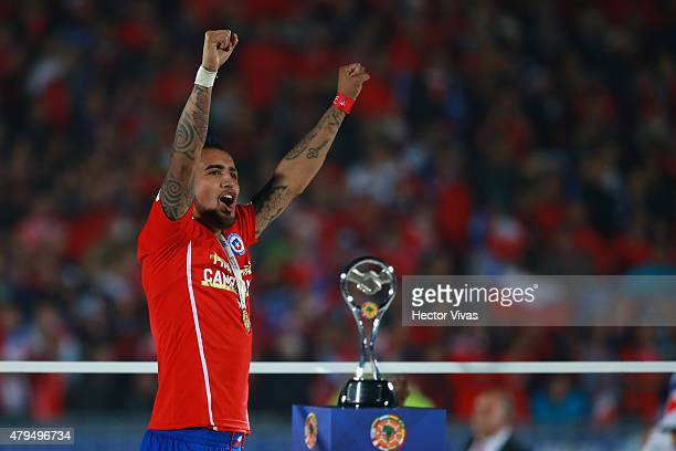 Arturo Vidal of Chile celebrates after winning the 2015 Copa America Chile Final match between Chile and Argentina at Nacional Stadium on July 04...