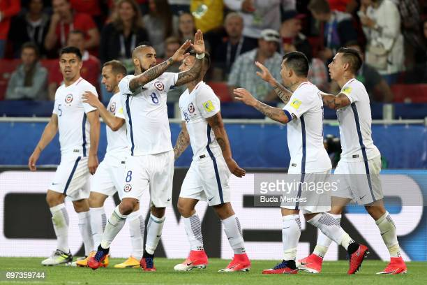 Arturo Vidal of Chile celebrates scoring his sides first goal with his Chile team mates during the FIFA Confederations Cup Russia 2017 Group B match...