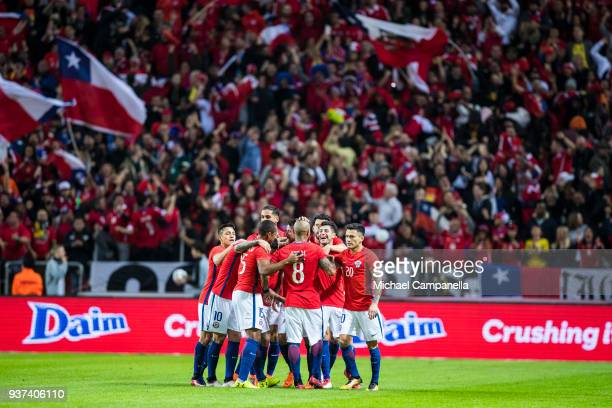 Arturo Vidal of Chile celebrates scoring the opening goal with teammates during an international friendly between Sweden and Chile at Friends arena...