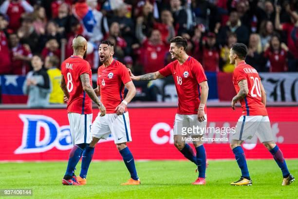 Arturo Vidal of Chile celebrates scoring the opening goal with teammates Angelo Sagal Mauricio Isla and Charles Aranguiz during an international...