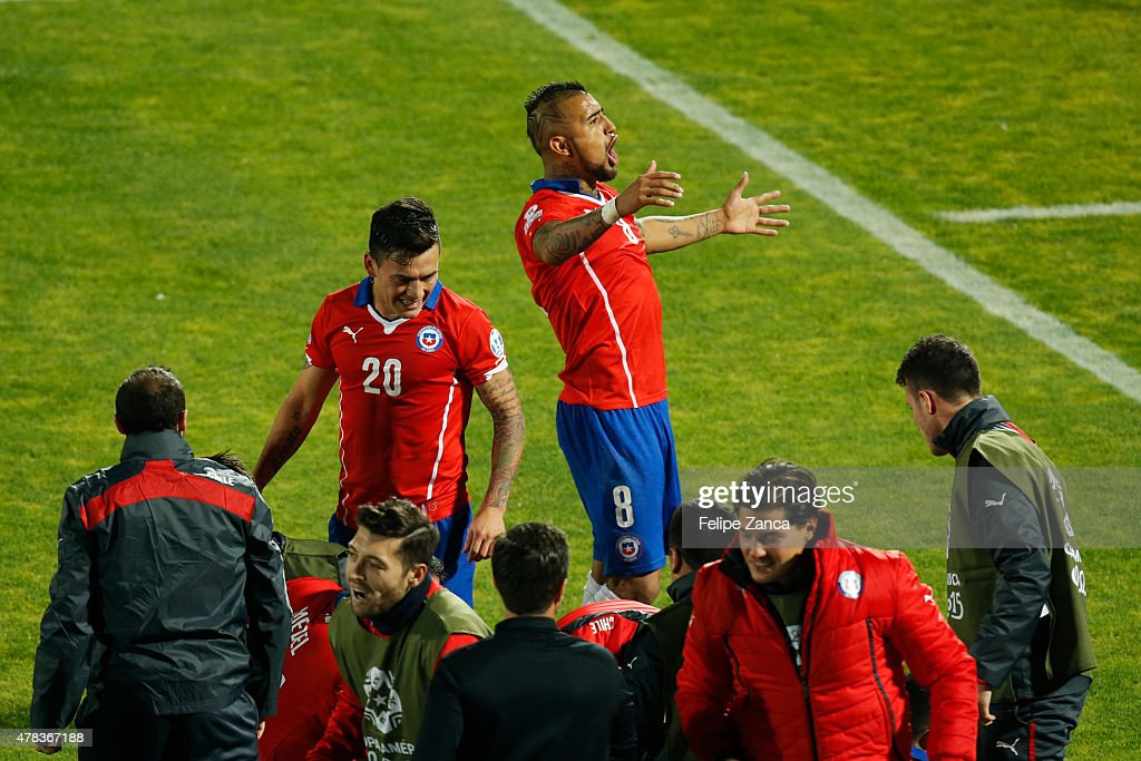 Arturo Vidal of Chile celebrates the opening goal scored by Mauricio Isla of Chile during the 2015 Copa America Chile quarter final match between Chile and Uruguay at Nacional Stadium on June 24, 2015 in Santiago, Chile.