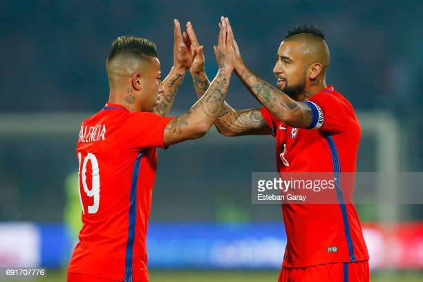 Arturo Vidal of Chile celebrates with teammate Leonardo Valencia after scoring the second goal of his team during a match between Chile and Burkina...