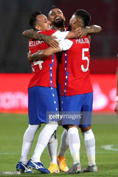 Arturo Vidal of Chile celebrates with teammates after scoring the first goal of their team during a match between Chile and Peru as part of South...