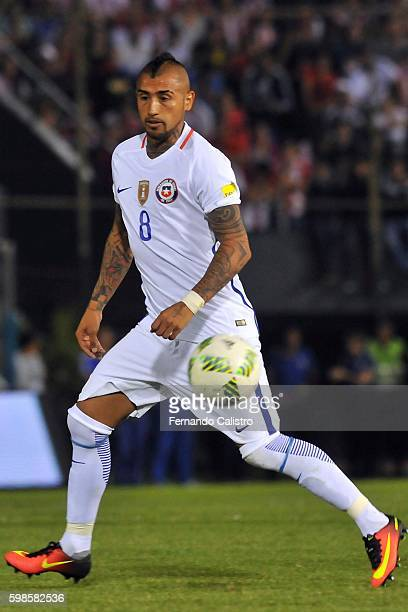 Arturo Vidal of Chile drives the ball during a match between Paraguay and Chile as part of FIFA 2018 World Cup Qualifiers at Defensores del Chaco...