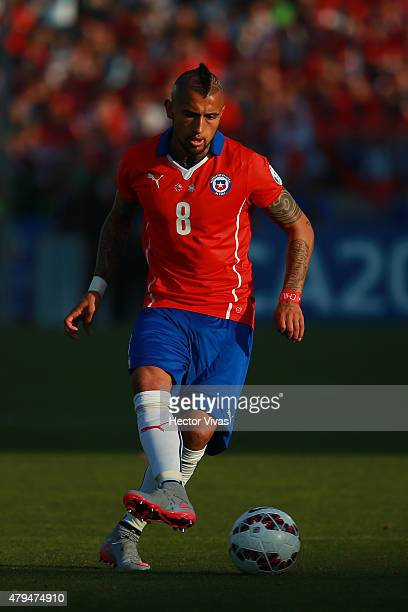 Arturo Vidal of Chile drives the ball during the 2015 Copa America Chile Final match between Chile and Argentina at Nacional Stadium on July 04, 2015...
