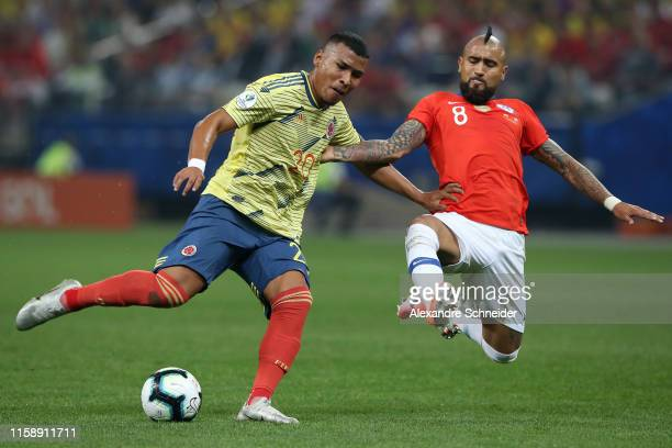 Arturo Vidal of Chile fights for the ball with Roger Martinez of Colombia during the Copa America Brazil 2019 quarterfinal match between Colombia and...
