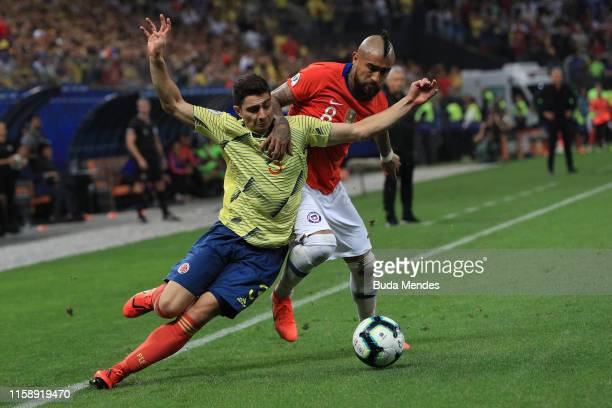 Arturo Vidal of Chile fights for the ball with Stefan Medina of Colombia during the Copa America Brazil 2019 quarterfinal match between Colombia and...