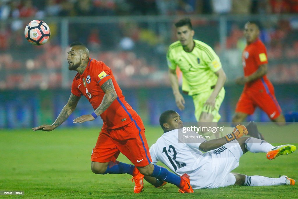 Arturo Vidal of Chile goes for a header during a match between Chile and Venezuela as part of FIFA 2018 World Cup Qualifier at Monumental Stadium on March 28, 2017 in Santiago, Chile.