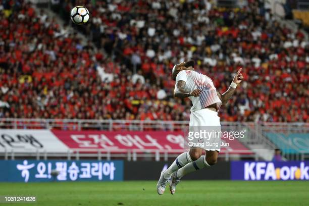 Arturo Vidal of Chile heads the ball during the International friendly match between South Korea and Chile at Busan Asiad Main Stadium on September...