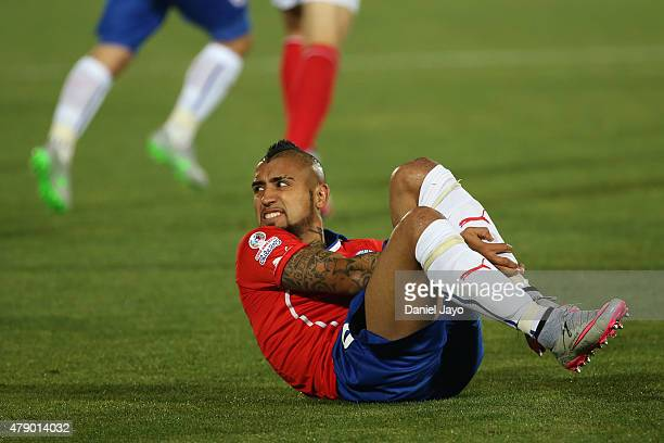Arturo Vidal of Chile lies injuried during the 2015 Copa America Chile Semi Final match between Chile and Peru at Nacional Stadium on June 29 2015 in...