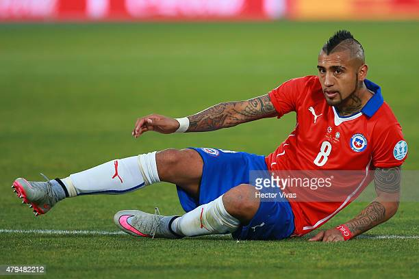 Arturo Vidal of Chile lies on the grass during the 2015 Copa America Chile Final match between Chile and Argentina at Nacional Stadium on July 04...
