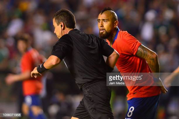 Arturo Vidal of Chile reacts against the referee Joel Antonio Aguilar during the international friendly match between Mexico and Chile at La...